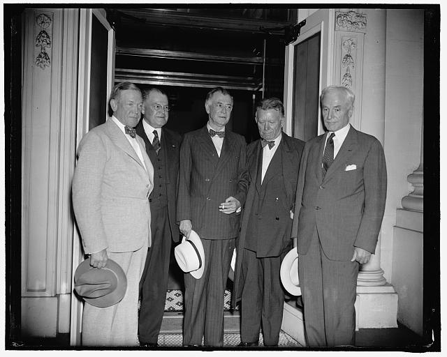 Emerging from the White House are Senator Charles L. McNary, Minority leader; Sen. Warren Austin of Vermont; Sen. Key Pittman, Chairman of the Foreign Relations Committee; Sen. William E. Borah of Idaho, and Secretary of State Cordell Hull (1939). Source: Library of Congress.